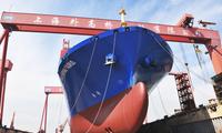 ――写在外高桥造船公司20000TEU集装箱船首制船顺利出坞之际